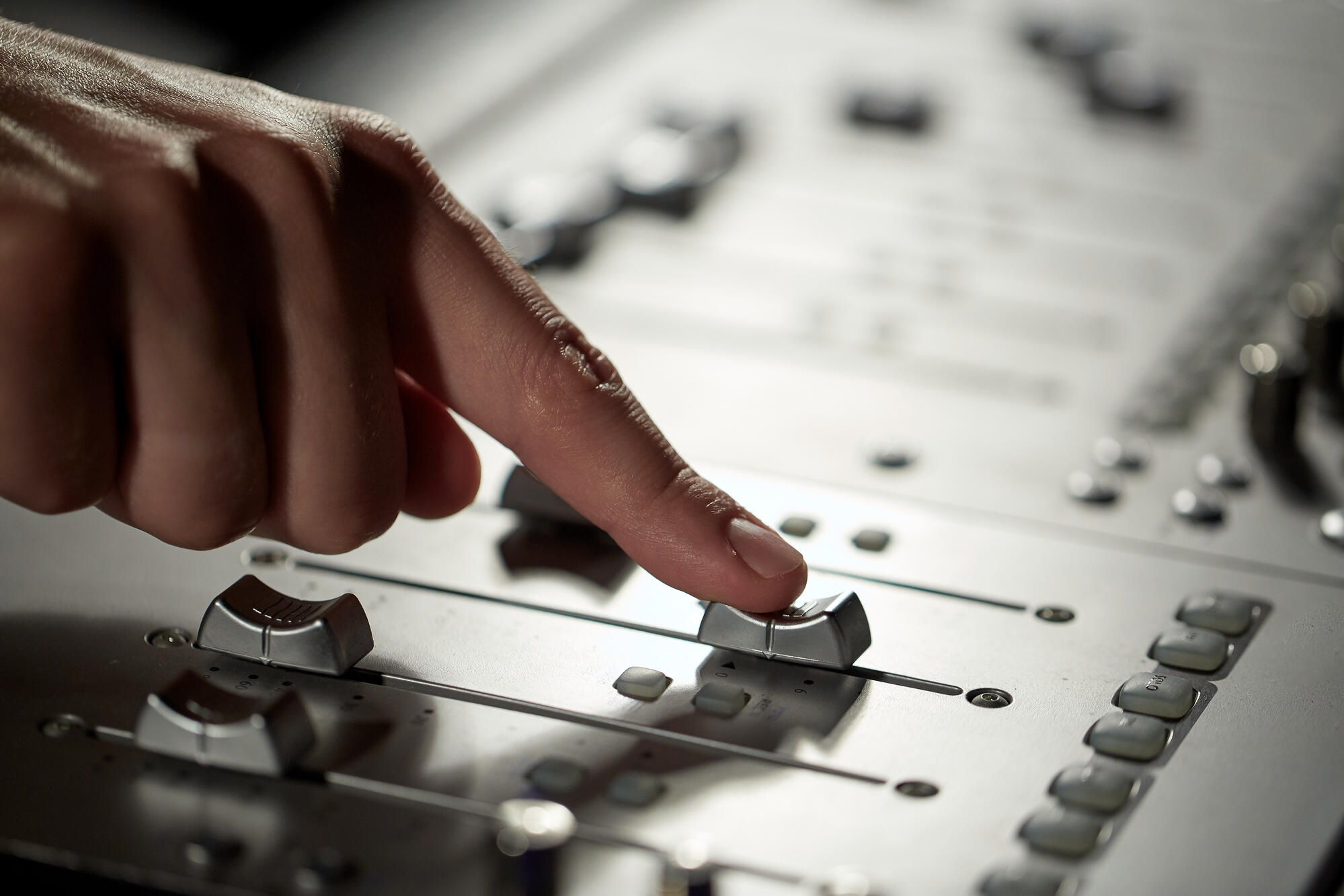 hand-with-mixing-console-in-music-recording-PAE586P